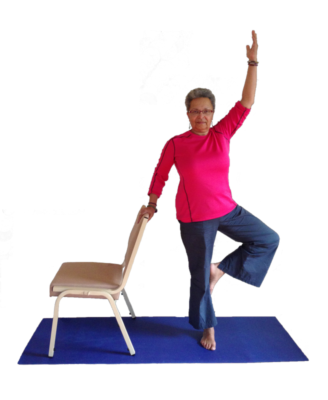 Beth holding onto chair for support while in yoga stance